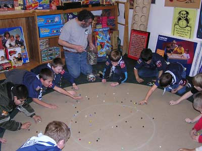 Bruce Teaching Marble Games to Scouts