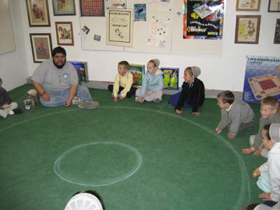 J Teaching Games to Kids at the Moon